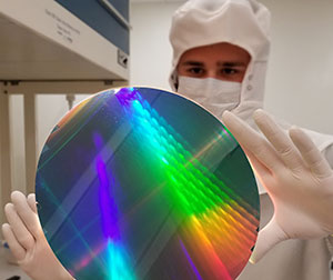 Wafer Level Manufacturing - Technician Holding 8 inch Wafer